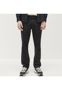 Czarne jeansy Reserved