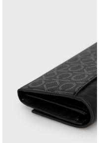 Calvin Klein - Portfel. Kolor: czarny. Materiał: materiał