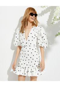 MARIANNA SENCHINA - Biała sukienka Eye Candy. Okazja: na randkę, na ślub cywilny, na wesele, na imprezę. Kolor: biały. Wzór: grochy. Długość: mini