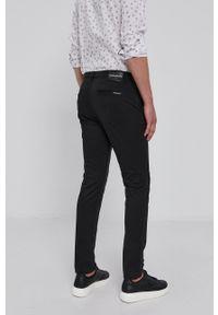 Calvin Klein Jeans - Spodnie. Kolor: czarny. Materiał: tkanina