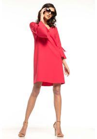 Tessita - Malinowa Wizytowa Luźna Sukienka z Kloszowanym Rękawem. Kolor: różowy. Materiał: poliester, elastan. Styl: wizytowy