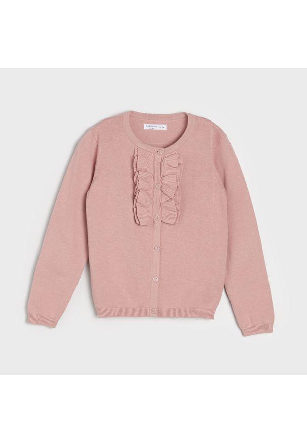 Różowy sweter Sinsay z falbankami