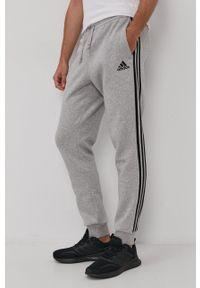 Adidas - adidas - Spodnie. Kolor: szary