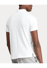 Ralph Lauren - RALPH LAUREN - Biała koszulka z logo Regular Fit. Typ kołnierza: polo. Kolor: biały. Materiał: prążkowany, bawełna. Wzór: haft. Styl: sportowy