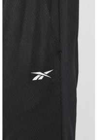 Reebok - Spodnie. Kolor: czarny. Materiał: materiał, tkanina, poliester. Wzór: gładki #2