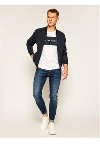 TOMMY HILFIGER - Tommy Hilfiger T-Shirt Logo Flag UM0UM01170 Biały Regular Fit. Kolor: biały