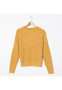 Żółty sweter House w ażurowe wzory
