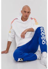 Niebieskie spodnie dresowe adidas Originals z nadrukiem
