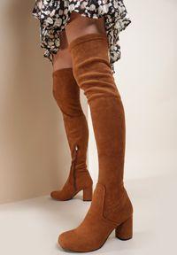 Renee - Camelowe Kozaki Like A Prayer. Wysokość cholewki: za kolano. Nosek buta: okrągły. Zapięcie: zamek. Materiał: jeans. Szerokość cholewki: normalna. Sezon: jesień, zima. Obcas: na obcasie. Wysokość obcasa: średni