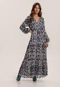 Renee - Niebieska Sukienka Galeendyl. Typ kołnierza: kokarda. Kolor: niebieski. Materiał: materiał. Długość rękawa: długi rękaw. Typ sukienki: kopertowe. Długość: midi