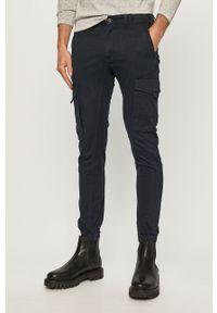 Jack & Jones - Spodnie. Okazja: na co dzień. Kolor: niebieski. Materiał: tkanina, elastan, bawełna. Wzór: gładki. Styl: casual #1