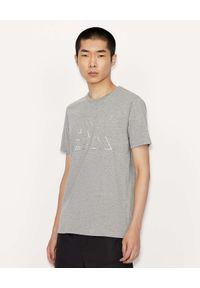 Armani Exchange - ARMANI EXCHANGE - Szary t-shirt z odblaskowym logo. Kolor: szary. Materiał: materiał. Wzór: nadruk
