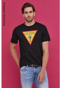 Guess - T-shirt z kolekcji urodzinowej. Okazja: na urodziny. Kolor: czarny. Wzór: nadruk. Styl: casual