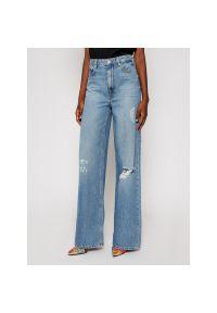 Niebieskie jeansy bootcut Guess