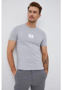 Calvin Klein Jeans - T-shirt bawełniany. Okazja: na co dzień. Kolor: szary. Materiał: bawełna. Wzór: nadruk. Styl: casual
