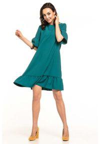 Zielona sukienka wizytowa Tessita z falbankami, na lato