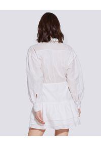 IRO - Biała sukienka z jedwabiem Josie. Typ kołnierza: kołnierzyk koszulowy. Kolor: biały. Materiał: jedwab. Długość rękawa: długi rękaw. Typ sukienki: koszulowe. Styl: wakacyjny. Długość: mini