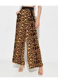 MYSTIQUE BEACH - Szerokie spodnie Safari. Stan: podwyższony. Kolor: brązowy. Materiał: szyfon, materiał. Wzór: nadruk. Styl: elegancki, klasyczny