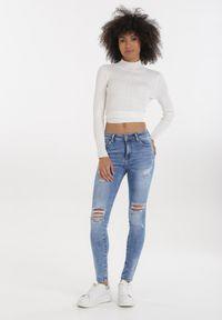 Born2be - Jasnoniebieskie Jeansy Skinny Hidanea. Stan: podwyższony. Kolor: niebieski. Długość: długie. Wzór: aplikacja