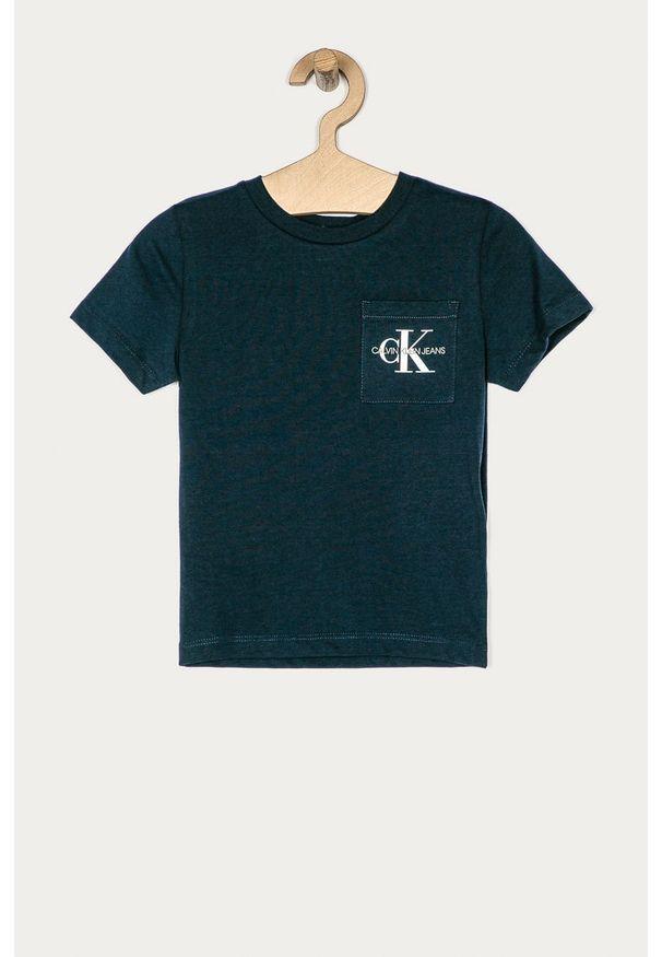 Niebieski t-shirt Calvin Klein Jeans z okrągłym kołnierzem, na co dzień, z nadrukiem