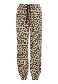 Cellbes Dżersejowe spodnie we wzory zwierzęce beżowy w cętki female beżowy/ze wzorem 54/56. Kolor: beżowy. Materiał: jersey. Wzór: motyw zwierzęcy