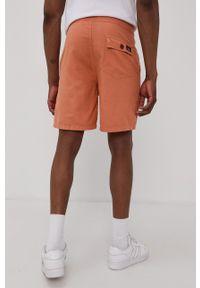 Superdry - Szorty. Kolor: pomarańczowy. Materiał: tkanina
