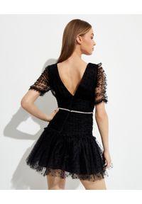 SELF PORTRAIT - Czarna sukienka mini w kropki. Kolor: czarny. Materiał: tkanina. Wzór: kropki. Typ sukienki: dopasowane. Długość: mini