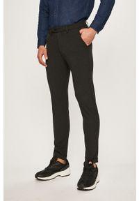 Jack & Jones - Spodnie Marco. Kolor: szary. Materiał: materiał, tkanina. Wzór: gładki