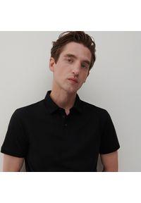 Reserved - Koszulka polo z bawełny organicznej - Czarny. Typ kołnierza: polo. Kolor: czarny. Materiał: bawełna