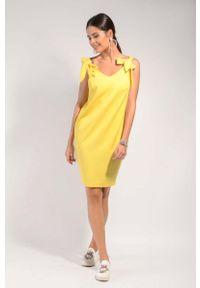 Żółta sukienka wizytowa Nommo wizytowa, z kokardą, prosta