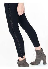 Czarne spodnie TOP SECRET na zimę, na co dzień
