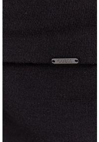 Guess - Sukienka. Kolor: czarny. Materiał: dzianina. Długość rękawa: długi rękaw. Wzór: gładki. Typ sukienki: dopasowane