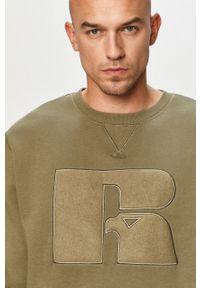 Oliwkowa bluza nierozpinana Russell Athletic z aplikacjami, bez kaptura, casualowa