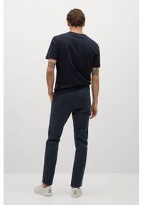 Mango Man - Spodnie PRATO. Kolor: niebieski. Materiał: tkanina. Wzór: gładki