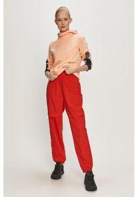 adidas Originals - Spodnie. Kolor: czerwony. Materiał: materiał