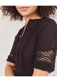 LOVE SHACK FANCY - Sukienka midi Rebecca. Kolor: czarny. Materiał: bawełna, koronka. Wzór: ażurowy, aplikacja, koronka. Typ sukienki: rozkloszowane. Długość: midi