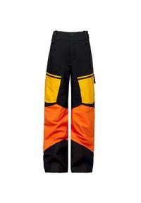 Żółte spodnie narciarskie Peak Performance