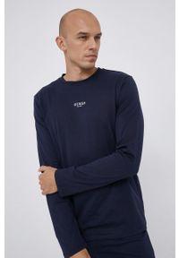 Guess - Komplet piżamowy. Kolor: niebieski. Materiał: bawełna, dzianina. Długość: długie. Wzór: nadruk