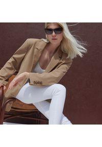 Reserved - Jeansy slim - Biały. Kolor: biały