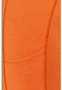 Pomarańczowe legginsy Calvin Klein Performance z nadrukiem