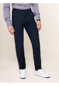 Tommy Hilfiger Tailored Spodnie materiałowe TT0TT05525 Granatowy Slim Fit. Kolor: niebieski. Materiał: materiał