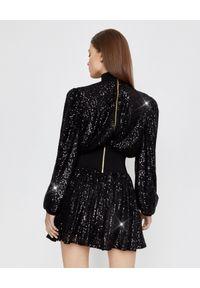 Balmain - BALMAIN - Sukienka mini z cekinami. Kolor: czarny. Materiał: tkanina. Wzór: aplikacja. Typ sukienki: rozkloszowane. Długość: mini