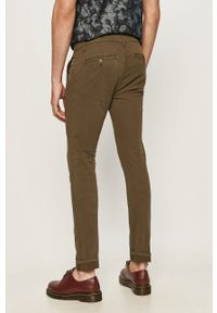 Guess - Spodnie. Kolor: zielony. Materiał: tkanina. Wzór: gładki