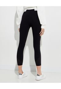 MONCLER - Czarne legginsy z logo. Kolor: czarny. Materiał: materiał. Wzór: aplikacja