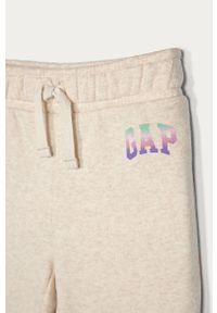 Beżowe spodnie dresowe GAP z nadrukiem