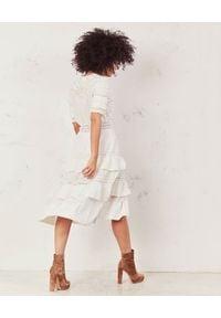 LOVE SHACK FANCY - Sukienka midi Rebecca. Okazja: na randkę. Kolor: biały. Materiał: bawełna, koronka. Wzór: kwiaty, koronka, haft, ażurowy, aplikacja. Styl: wakacyjny, boho. Długość: midi