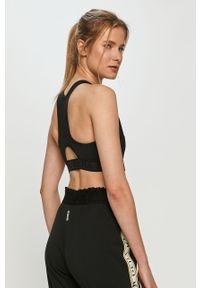Czarny biustonosz sportowy Deha gładki, z odpinanymi ramiączkami