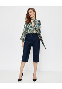 ICON - Granatowe spodnie Culotte z wełny. Stan: podwyższony. Kolor: niebieski. Materiał: wełna. Styl: elegancki