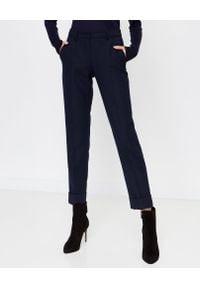 SEDUCTIVE - Granatowe spodnie w kant. Kolor: czarny. Materiał: materiał. Styl: elegancki, klasyczny