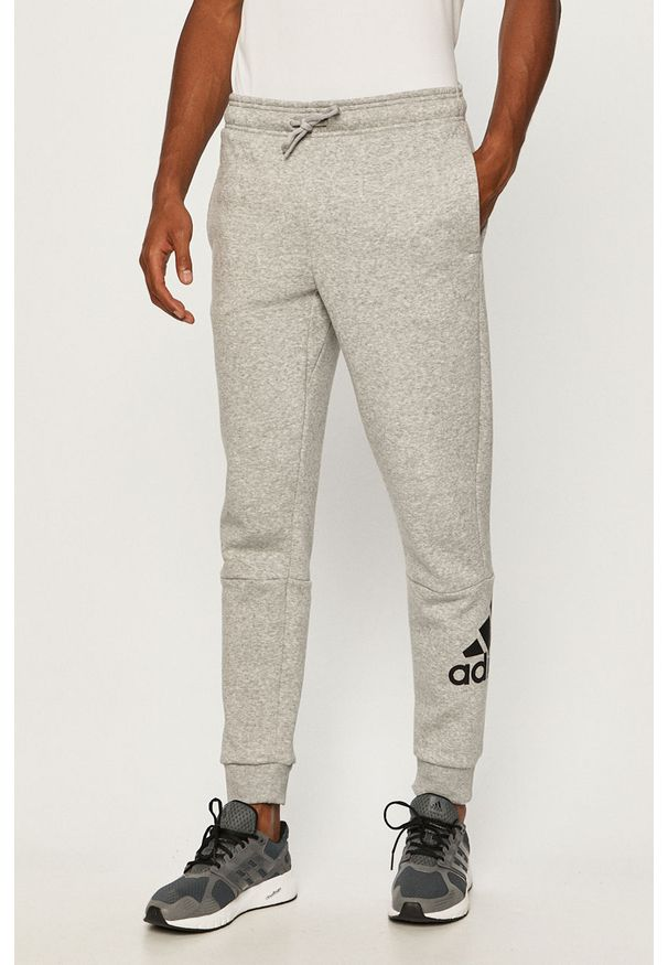 Szare spodnie dresowe adidas Performance z nadrukiem